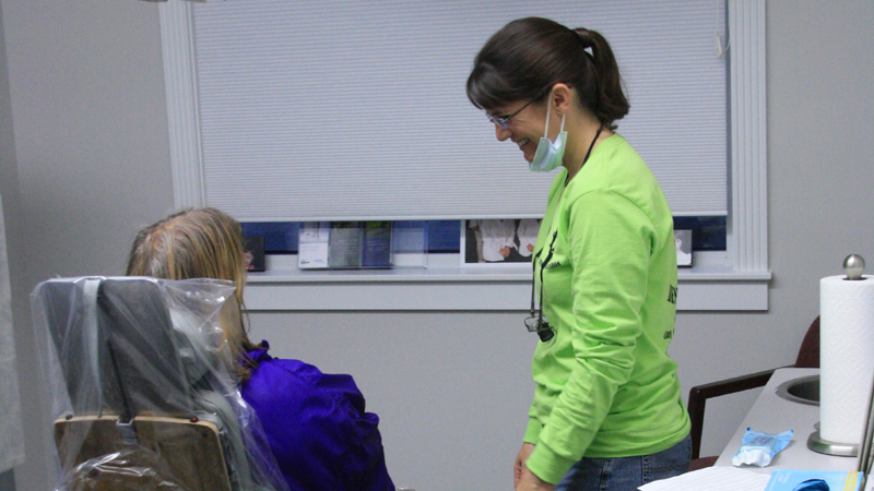Team member with a patient on Clay Center Family Dental Care Dental Mission day