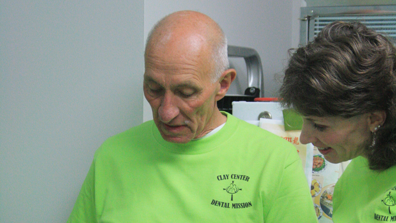 Two team members on Clay Center Family Dental Care Dental Mission day
