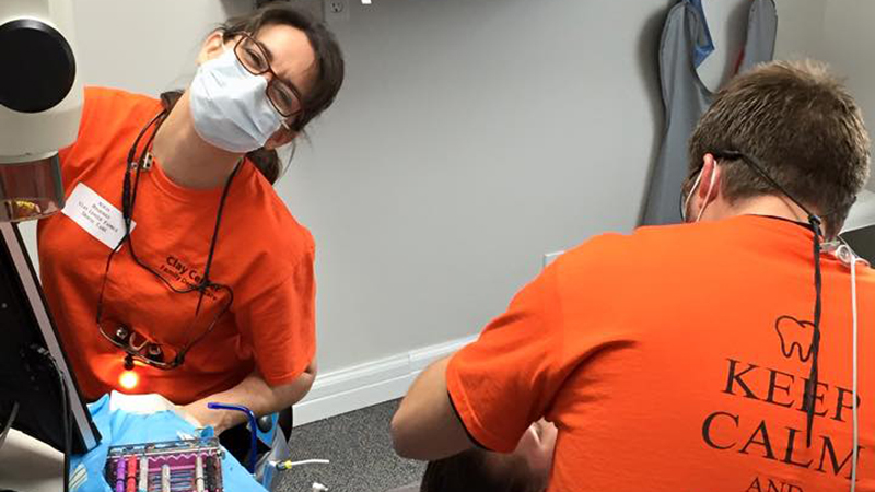 Dr Kruse and team member working on a patient on Clay Center Family Dental Care Dental Mission day