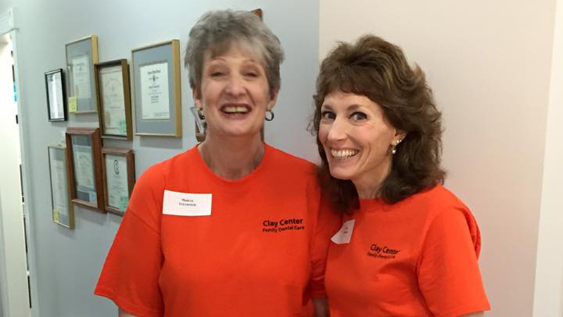 Two female team members on Clay Center Family Dental Care Dental Mission day
