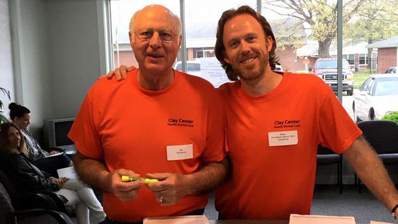 Two male team members on Clay Center Family Dental Care Dental Mission day