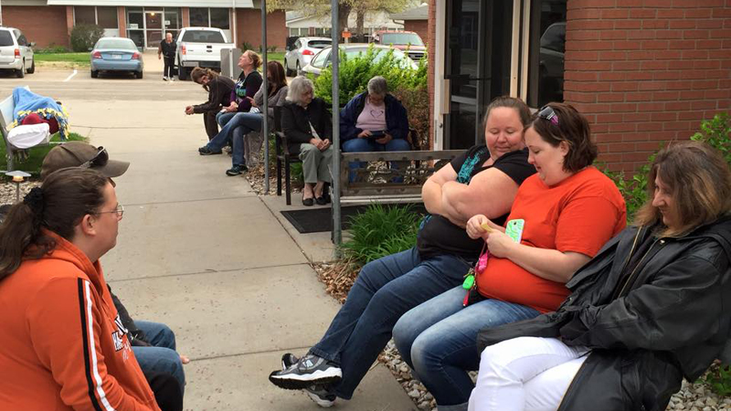 Patients waiting in front of Clay Center Family Dental Care for dental treatment on Clay Center Dental Mission day