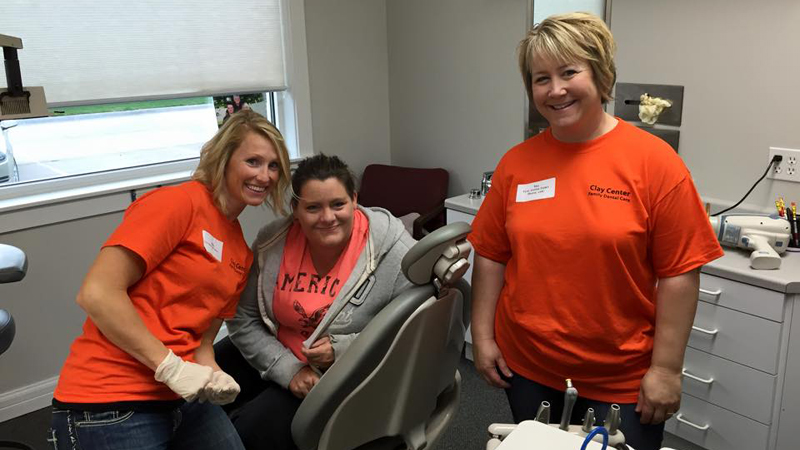 Team members and a patient on Clay Center Family Dental Care Dental Mission day